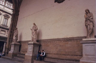 Roman statues of women along the back wall